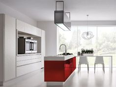 Red gloss kitchen in a modern & uncluttered slab style.