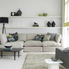 A new twist on green, white and black with long living room shelves