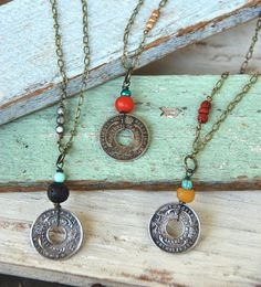 Choose one of these Bohemian coin necklaces. features assorted vintage coins,assorted vintage glass beads,recycled glass beads,gemstone beads,antique brass chain measures 16 drops about 1 1/2-2 with charm and finishes with a lobster claw. Select the main bead color above the coin on