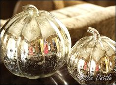 plastic pumpkins coated in looking glass spray paint?