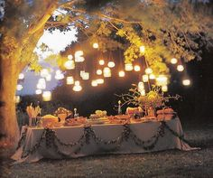 hanging lights over food table for wedding