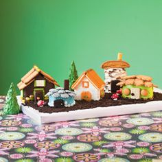 Fanciful Fairy Village Cake....I don't think I'll go this route but it's pretty awesome!