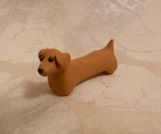 http://www.etsy.com/listing/97009332/dachshund-handmade-fimo    fimo dachshund!