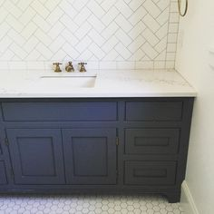 Checking up on this herringbone & hex bath in the . Covering it with a mirror just feels wrong! {paint color is Benjamin Moore cheating heart} Vanity color - boys bath Navy Bathroom, Bathroom Renos, Bathroom Renovations, Small Bathroom, Bathroom Ideas, Bathroom Vanities, Family Bathroom, Bathroom Organization, Bathroom Storage