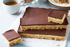 Anzac biscuits add a chewy coconut texture to this irresistible chocolate and caramel slice. Easy Anzac Biscuits, Buttery Biscuits, Chocolate Biscuit Recipe, Chocolate Biscuits, Cheesecake Toppings, Cheesecake Bites, Easy Slice, Chocolate Slice