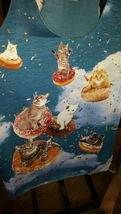 Kitties on flying doughnuts!  Too cute!  Meow!