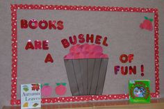 """""""Fall"""" themed bulletin board- make the bucket 3D and make colored copies of book covers."""