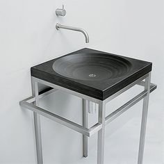 Love the Bauhaus sink from Maxim, in chromium steel and solid slate.    The durability of the materials together with neutral colouration provides practicality with a functional, industrial edge.