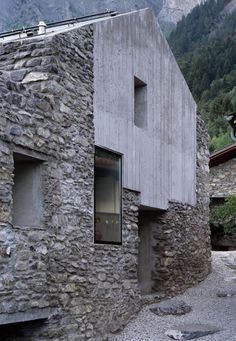 Facade Housing Brick Concrete Transformation  Roduit House Transformation, Chamoson, Switzerland by Savioz Fabrizzi Architectes.  Photo: Thomas Jantscher