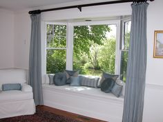 Bay Window Idea - I like the clean look of the actual windows and the extra seating.