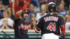 Cleveland Indians Francisco Lindor gives Carlos Santana  congrats after Santana scored on a Jason Kipnis double in the 5th inning against the Kansas City Royals at Progressive Field in Cleveland, Ohio on September 21, 2016.  Indians won 4-3  (Chuck Crow/The Plain Dealer)