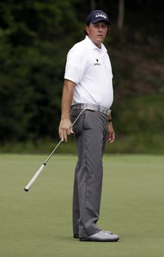 Phil Mickelson watches his putt