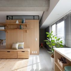 Sinato hides two bedrooms behind an  L-shaped wall in Fujigaoka M apartment