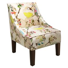 Bring a pop of style to your living room or den seating group with this eye-catching pine wood accent chair, featuring a swoop-arm silhouette and floral fan-...