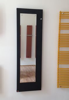 Onyx Mirror: Flat panel radiator with mirror. Mirror radiator with hook. Central heating radiator. Bathroom mirror that heats. Designer radiator with wide use. Classic or central connection. Available with stainless steel or chrome rails. Delivery: 4 weeks.