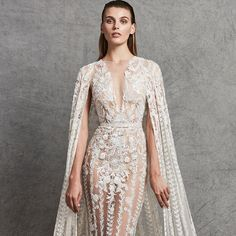 """Simply no words!!! Exclusive sneak preview of Zuhair Murad Fall 2018 Wedding Collection featuring show-stopper style """"Cyndi"""" V-neck sheath gown featuring opulent embroidery and detachable matching dramatic cape! Available next April at Belle & Tulle Bridal! @zuhairmuradofficial #zuhairmurad #zuhairmuradofficial #zuhairmuradbridal #newcollection #wedding #weddinggown #weddingdress #weddinginspiration #bridal #bride #belleandtulle #bridalstore #singapore #behindthescenes #sneakpeek #bridalgown…"""