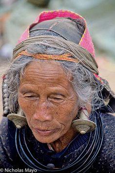 Western China   Wa woman wearing traditional earrings. Yunnan   ©Nick Mayo