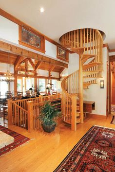 A spiral staircase adds interest to this home Heart Pine Flooring, Pine Floors, Wide Plank Flooring, House Stairs, Spiral Staircase, Carlisle, Inspired Homes, Homesteading, Decorating Your Home