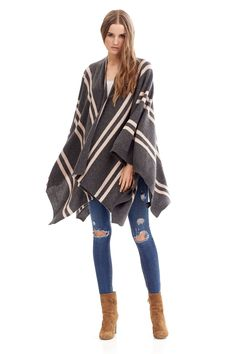 400 grams of 100% pure cashmere in 9-gauge knit Draped open front silhouette Adorned with contrasting stripes Side button closures Hand Wash Naked or Dry Clean Only