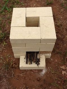 Brick Rocket Stove (This looks like a good backyard idea too. Outdoor Stove, Outdoor Fire, Outdoor Living, Outdoor Decor, Diy Rocket Stove, Rocket Stoves, Camping Survival, Survival Prepping, Survival Shelter