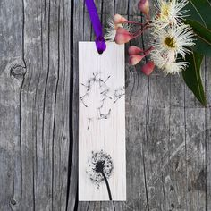 Keep track of your place in a favourite book, journal or magazine with this unique handmade wood dandelion bookmark. You will no longer need to reach for an old receipt or scrap of paper to mark your place…and no more folding the corners of pages! Each bookmark is handmade in Australia using lightweight, flexible wood, gorgeous photo image transfer and finished with coloured ribbon. #stitchandwood #bookmark #dandelion # giftidea Flexible Wood, Wood Transfer, Ribbon Colors, Book Journal, Are You The One, Bookmarks, Mall, Dandelion, Great Gifts