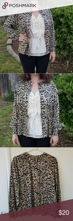 Adrianna Papell animal print silk blouse Soft, light, flowing, and beautiful! Gorgeous work button up for layering or to wear closed on it's own. Animal print is so fun. 100% silk. Snatch it up! Adrianna Papell Tops Button Down Shirts