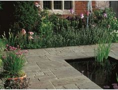Vintage Stone Raven Paving is original quartzitic sandstone in brown to black shades, providing a perfect setting for traditional properties - photos and brochure online. Patio Slabs, Vintage Patio, Block Paving, Garden Paving, Shades Of Black, Raven, Natural Stones, Concrete, Sidewalk