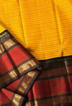 Lemon Yellow Kanjivaram Saree is from Akshaya Creations Boutique. The saree is having rich gold zari border and pallu has a simple zari strip at the end. Kanjivaram Sarees Silk, Kanchipuram Saree, Soft Silk Sarees, Cotton Saree, South Indian Sarees, Ethnic Sarees, Saree Color Combinations, Nauvari Saree, Yellow Saree