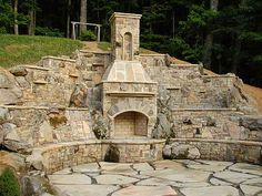 Stone fireplace within retaining wall
