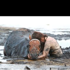 This girl stayed by her horse's side after it had sunk into the mud at the ocean. She held his head up as the tide came in to keep him from drowning, and yes he was rescued and is safe and sound. This is true Love!!!!