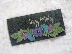 Simon background stamp and reverse confetti flowers