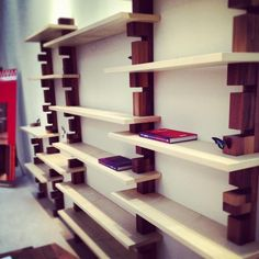 """""""Shark"""" Shelves by Morelato. Simple design slots shelves easily at any height via the """"tooth"""" cuts."""