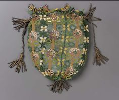 Drawstring bag, bibila work, vertical stripes of different flowers in colored silks.