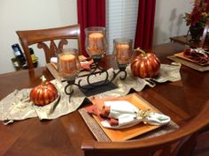 Fall tablescape featuring Pier 1 Amber Luster Centerpiece with Spice Route Dinnerware and Rattan Chargers I have this candle set!