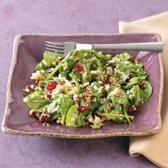 Quinoa Wilted Spinach Salad Recipe -Get all the nutritious benefits of quinoa, spinach and cranberries paired with the crunchy texture of nuts in this easy and scrumptious salad. A light, flavorful dressing splashed with citrus tops everything off! —Sharon Ricci, Mendon, New York
