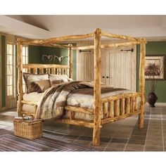 Deluxe Aspen Log Canopy Bed. (I like rustic log furniture in a rural home . . . I'd put this baby up against a wall, but that's just me.) ✭~~hh/