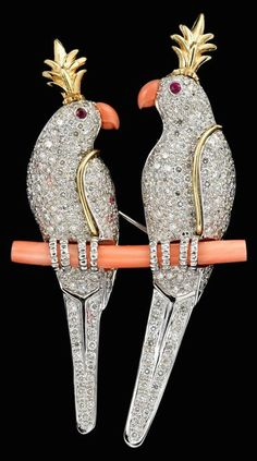 Platinum and diamond 'two birds' brooch, Tiffany & Co. schlumberger 2 pave diamond set parakeets enface displayed on coral branch, each bird with a carved coral beak, ruby set eye and 18 karat yellow gold head plume, signed by the maker and designer.♥༺❤༻♥