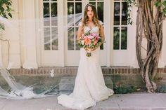 Ruffled - photo by Lillywhite Photography http://ruffledblog.com/wearing-her-sisters-wedding-dress | Ruffled