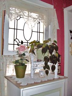 my cottage window with lovely lace curtain valence and a little wicker chair planter