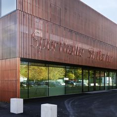 Sports Hall St. Martin / Dietger Wissounig Architekten Copper façade made of folded perforated metal plates covering the hall like a semi-transparent veil. The copper sheets are staggered by one folded element at each storey which structures the front horizontally