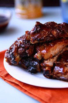 Amazing orange sweet and sour sauce slathered over meaty St. Louis style ribs and caramelized over high heat. Sticky Ribs Recipe, Pork And Beef Recipe, Pork Rib Recipes, Grilling Recipes, Slow Cooker Recipes, Cooking Recipes, Smoker Recipes, Cooking Videos, Asian Recipes