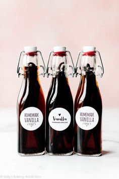How to make homemade vanilla extract with just vanilla beans and vodka. Bourbon is another great choice, too! Tutorial and free printable labels on sallysbakingaddiction.com