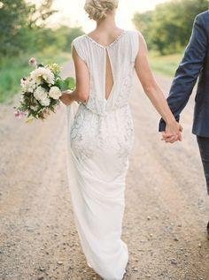 Beautiful Vintage style wedding dress with key hole back and delicate beading