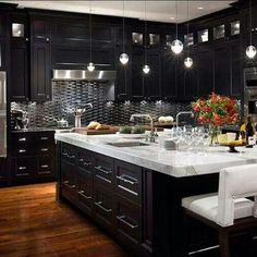 LOVE, LOVE, LOVE this elegant kitchen!! Modern contemporary kitchen with gorgeous marble counters. Sophie Mogk Toronto Real Estate
