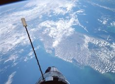 39. Gemini 12, docked to Agena, with the hatch open, a view of Florida below.  NASA/JSC/ASU