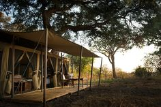 A classic expeditionary safari camp in a million acres of mammals; sitting amongst the elephants, bellowing hippos and tamarind trees. African Safari, Tent Camping, Tanzania, Acre, Gazebo, Outdoor Structures, Remote, Travel, Voyage
