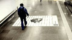 The poster was stuck to the road of subway people usually walk across. Every footprint would be imprinted to the poster and made a whole new meaning to the poster. It formed a jail that locked the bear.