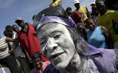 Mambo, a voodoo priestess, participates in a ceremony to commemorate the Day of the Souls