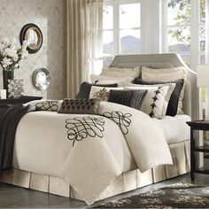 The Portia bedding ensemble is a cream color with various black swirl accents and fleur de lis motifs. Embroidery and beading are implemented on the decorative pillows of this ensemble.  The Portia bedding ensemble is shown here with an optional coverlet pictured.  100% cotton, 100% polyester filling  Free Shipping on this product. $630