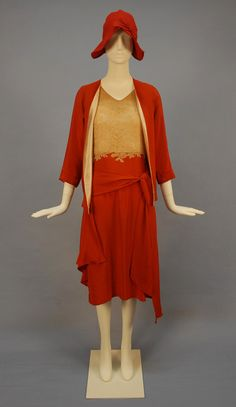 DECO SILK and LACE WEDDING ENSEMBLE, c. 1930. Sleeveless dress having ecru Alencon lace bodice and gored tomato red crepe wrap skirt, matching collarless jacket with 3/4 sleeve, lined in silk charmeuse. Matching wool felt cloche with bow detail and St. Louis label. B-34, L-43, jacket L-25. dress good, hat excellent. $240.